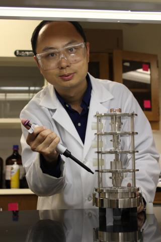 photo of Dr. Tony Zhou in lab