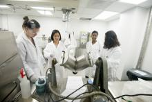 Researchers with lab equipment